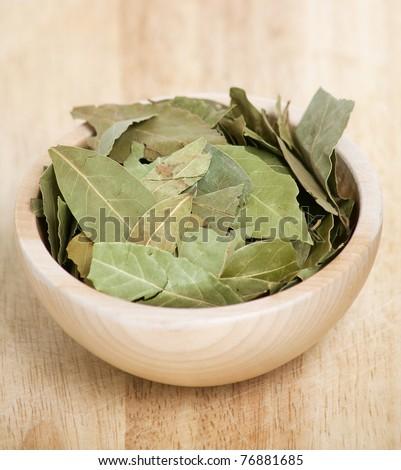 laurel leafs on wooden board