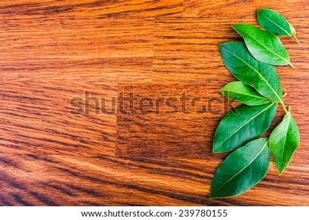 laurel  leaves   on a  brown wooden board
