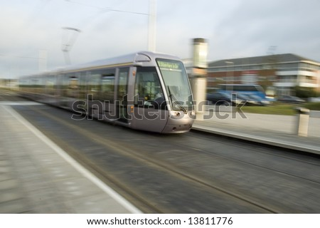 Laus Tram travelling at high speed in Dublin - stock photo