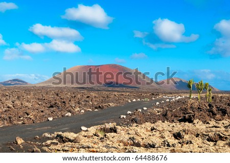 Lava Fields and a road leading to the mountains of fire, Timanfaya National Park in Lanzarote Island