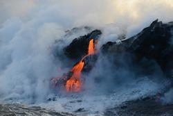 lava flow to pacific ocean at big island, hawaii
