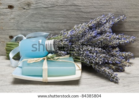 Lavender and some hygiene items made of lavender on an old wooden shelf.