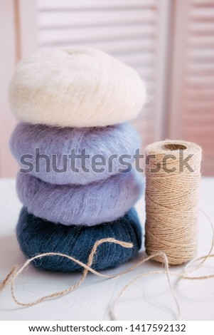 Lavender and white mohair skeins and cord for hobbies like knitting and crocheting