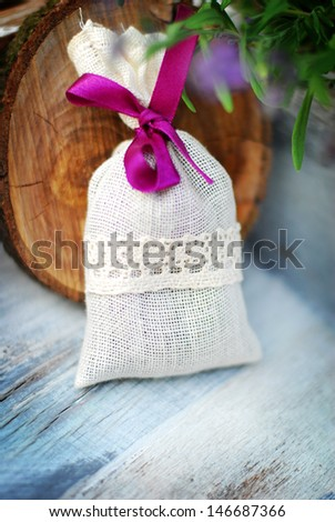 lavender bag and some fresh lavender flowers on at wooden box
