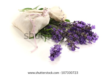 Lavender bag with purple flowers and green leaves on a light background
