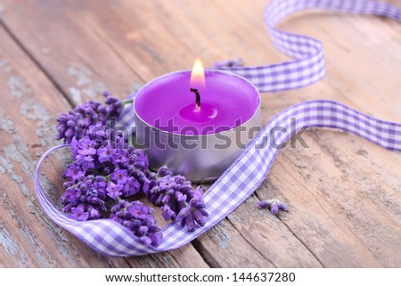 Lavender, Daisy Flowers And Scented Candle On Wooden Table Stock ...
