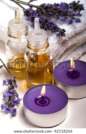 Lavender Essential Oil, Scented Candles And Fresh Flowers Stock ...