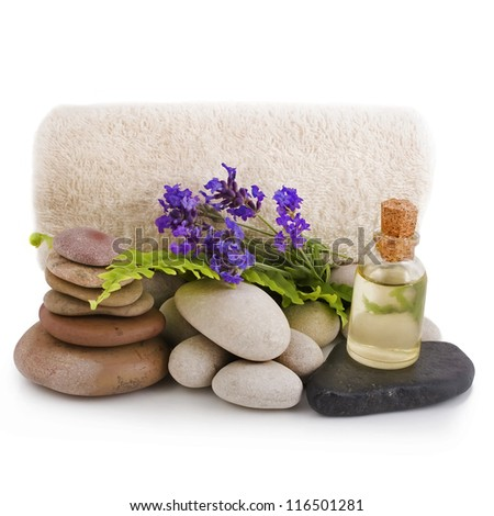 Lavender, essential oil, white stones and towel on a white background