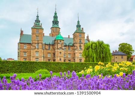 lavender flowerbed in gardens of Rosenborg Castle in Copenhagen, Denmark. Garden and Rosenborg Palace in Copenhagen. Tourist famous places in Copenhagen