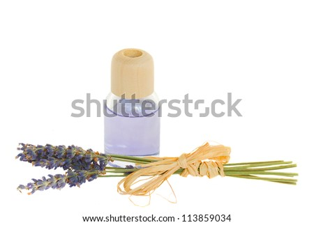 Lavender flowers and aroma oil isolated on white