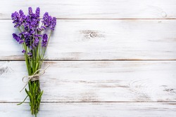 Lavender flowers, bouquet, overhead on white wooden background