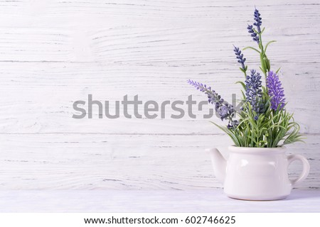 Lavender flowers in watering can, wooden background, copy space #602746625