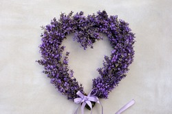 Lavender heart wreath on white background close-up