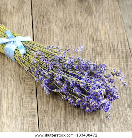 Lavender herb bunch on the oak table with copy-space