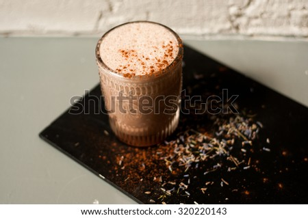 lavender hot cocoa drink on concrete background cool shadows natural light background #320220143