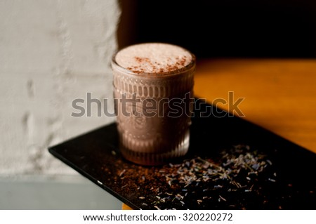 lavender hot cocoa drink on concrete background cool shadows natural light background #320220272