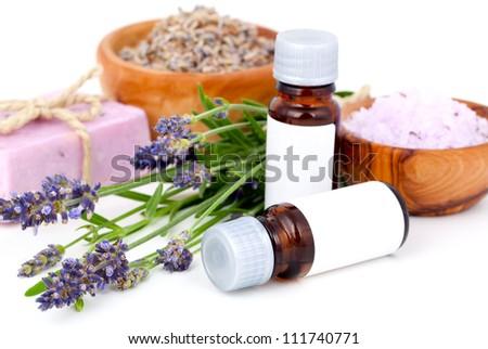 Lavender oil, lavender bath salt, soap on white background