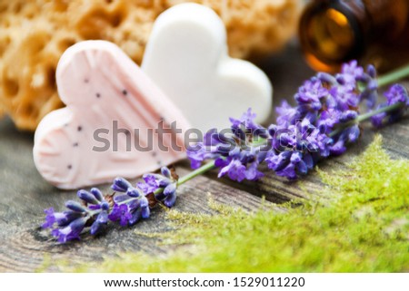 Lavender soap and oil with fresh blossoms