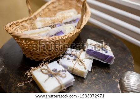 Lavender soap and salt in a wicker basket. A gift for guests. #1533072971