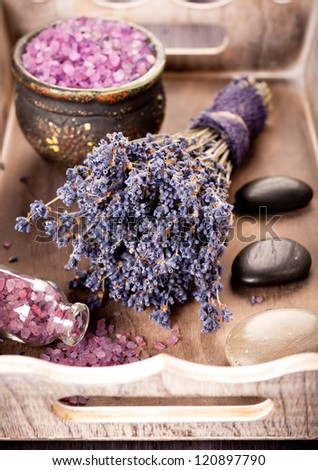 Lavender spa and zen stones in a rustic tray