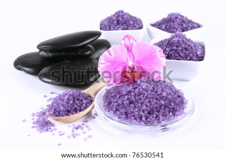 Lavender spa salt, spa stones and an orchid flower