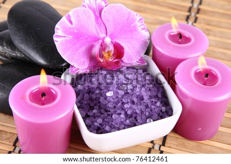 Lavender spa salt, spa stones, candles and an orchid flower