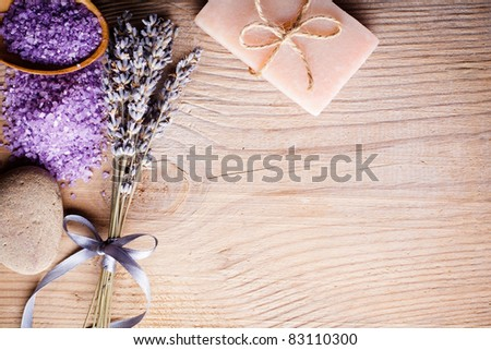 Lavender treatment soap, sea salt and stone on wooden table with copy space