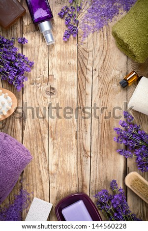 Lavender wellness products on wooden table. Copy space. Top view