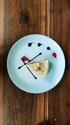 Lavish Cheesecake on a dark oak table.