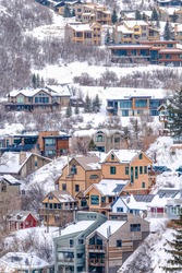Lavish houses in a picturesque neighborhood in the mountains with snow in winter