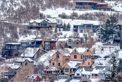 Lavish mountain homes on snow covered slopes in a scenic winter landscape