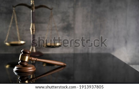 Law and Justice concept. Mallet of the judge. Gray background, place for typography. Courtroom theme.