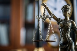 Law and Justice concept with gavel and scale in background. Composition in court library