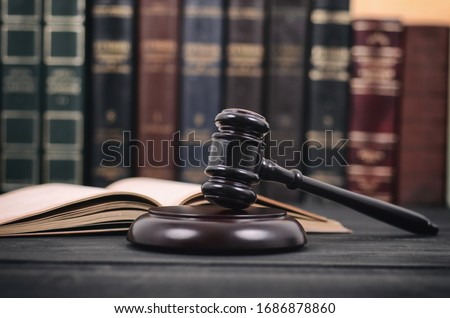 Law and Justice , Legality concept, Judge Gavel and law book on a black wooden background, law library concept. Foto d'archivio ©