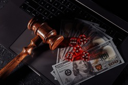 Law and rules for online gambling, judge gavel and dice