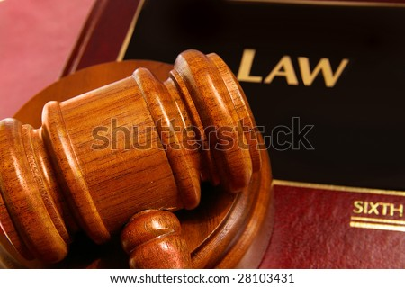 law book and judges gavel closeup from above