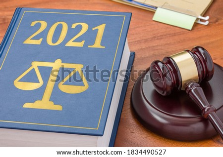 Law book with a gavel - 2021 Stock photo ©