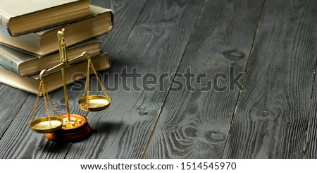 Law concept - Open law book with a wooden judges gavel on table in a courtroom or law enforcement office isolated on white background. Copy space for text. Zdjęcia stock ©