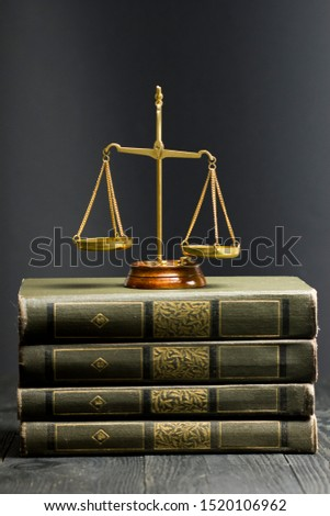 Law concept - Open law book with a wooden judges gavel on table in a courtroom or law enforcement office isolated on white background. Copy space for text. Сток-фото ©
