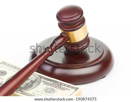 Law gavel on a stack of American money.