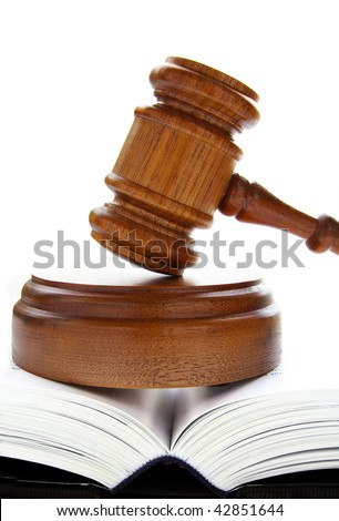 law gavel on an open lawbook, over white