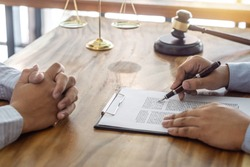 Law, lawyer attorney and justice concept, Consultation between a male lawyer and client, giving advice and prosecutions about the regarding real estate, report of the important case in the workplace.
