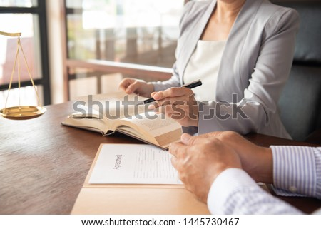 Law, Legal advice, Legislation concept. Lady justice on law book with lawyer team meeting in law office. Photo stock ©