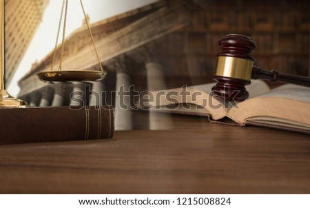 law, legal, jurisprudence concept. double exposure of Judge gavel on law books with scales of justice and court government background.