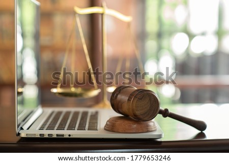 law legal technology concept.  judge gavel on computer with scales of justice on desk of lawyer. Stock photo ©