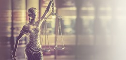 Law office banner concept image, Scales of Justice with legal books in background.