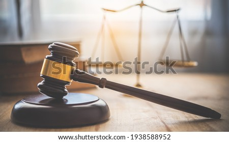 Law theme, mallet of the judge, law enforcement officers, evidence-based cases and documents taken into account.