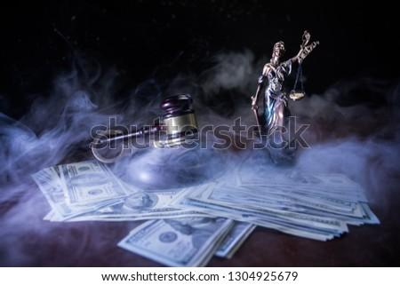 Law theme, mallet of the judge on wooden desk with Lady Justice Statue. Concept For Corruption, Justice, Law, Bankruptcy Court, Bail, Crime, Bribing, Fraud. Law gavel with handcuff and money Stock photo ©