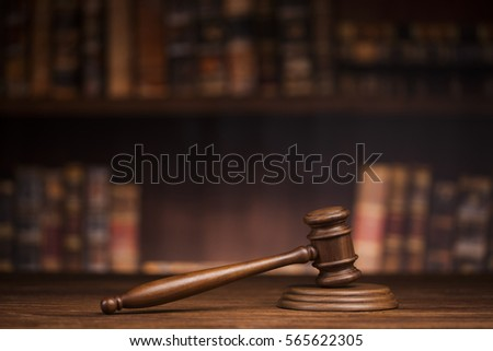 Law theme, mallet of the judge, wooden desk, books