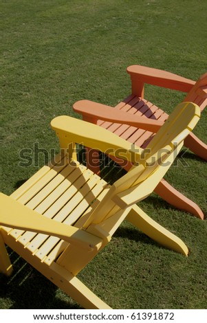 lawn chairs sitting on green lawn
